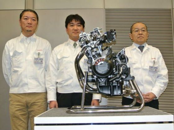 Honda officials posing with the new 400cc motor