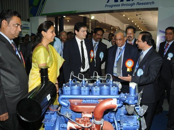 Dignitaries having a look at the diesel engine developed by ARAI