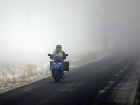 Motorcyclist riding in fog