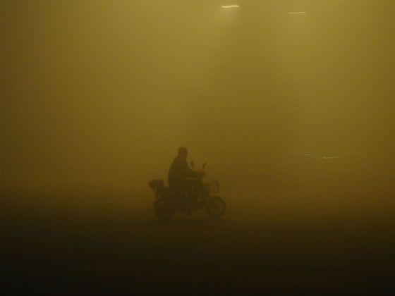 Rider making his way through thick fog