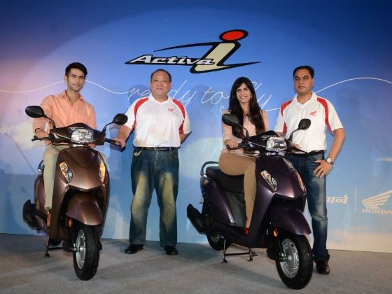 Honda officials pose with the Activa-i at its launch