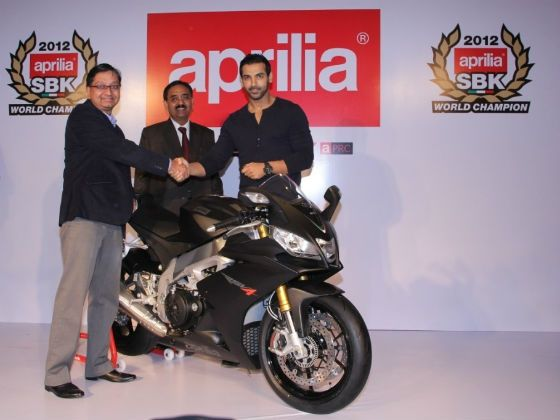 John Abraham with Piaggio officials at the Aprilia RSV4 handing over ceremony