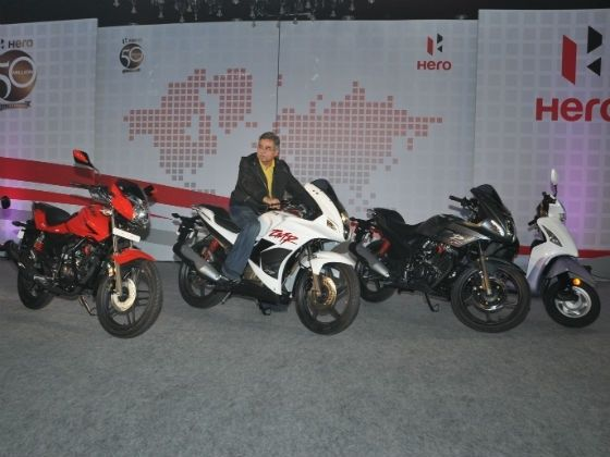 Pawan Munjal posing with the new range of bikes which were showcased recently