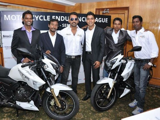 Riders pose with the TVS Apace RTR 180 at IML press launch