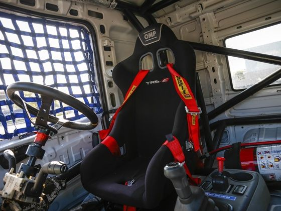 The stripped cabin with bucket seats in the new 2015 Tata T1 Prima Race truck